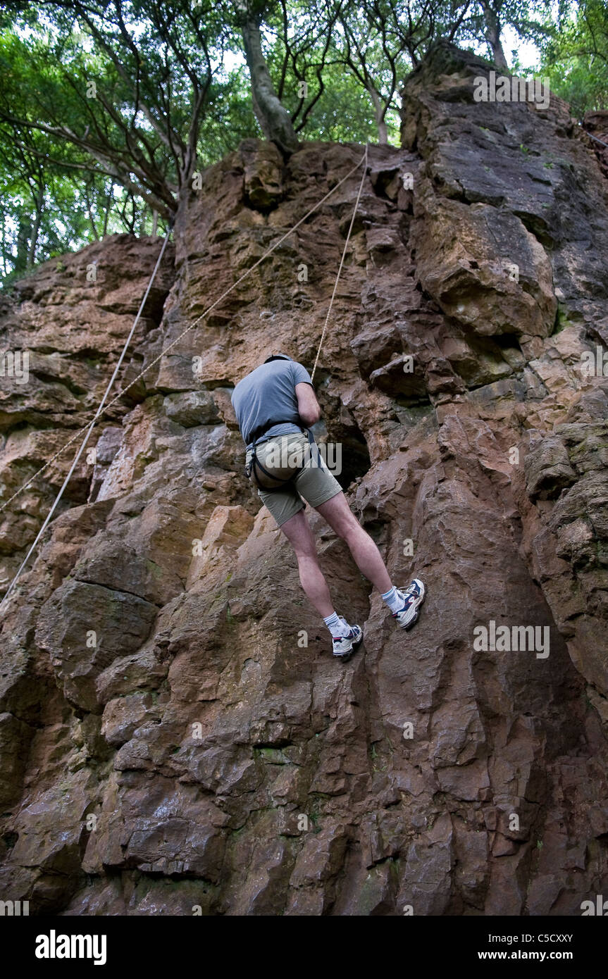 Rock climbing with ropes at Symonds Yat, Forest of Dean, Gloucestershire, UK - Stock Image