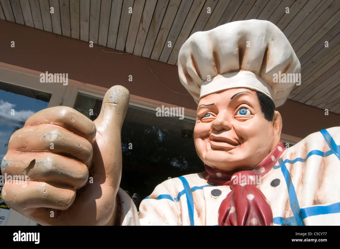 food critic critics happy chef chefs thumbs up good food meal meals great food restaurant restaurants review star - Stock Image