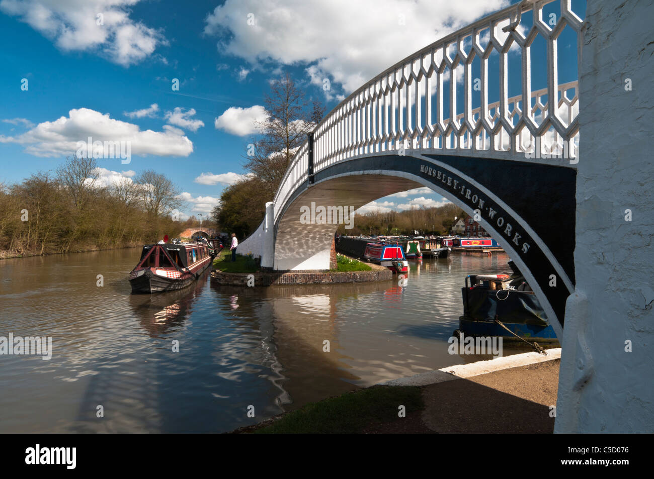 Narrowboat being moored on the Grand Union Canal beside the ornate arched bridge at Braunston Marina, Northamptonshire, - Stock Image