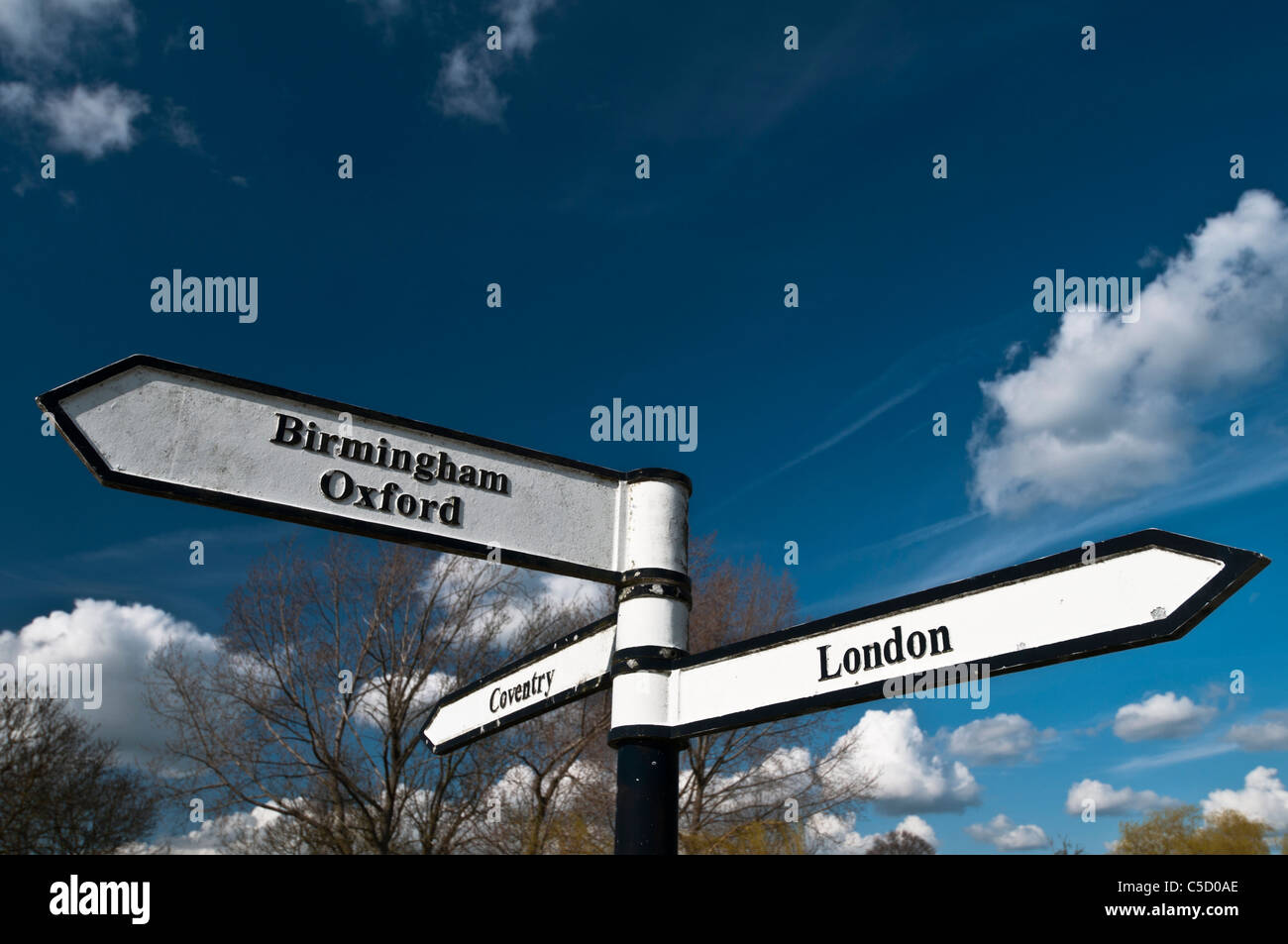 A canalside signpost at Braunston Junction where the Grand Union and Oxford canals meet, Braunston, Northamptonshire, - Stock Image