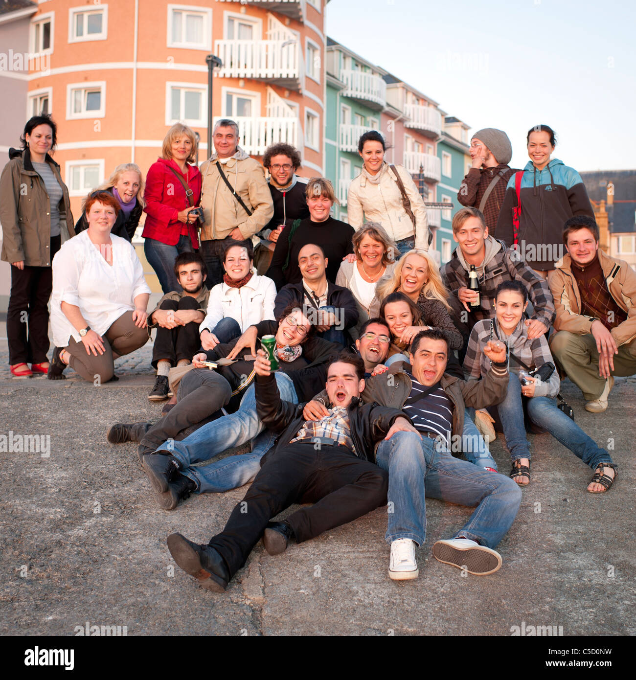 a group of language school students celebrating the end of their course Aberystwyth Wales UK - Stock Image