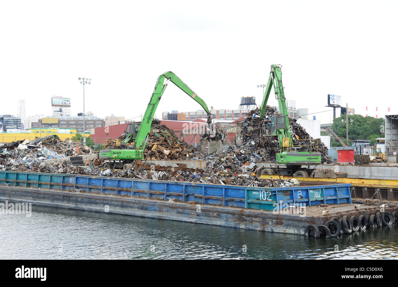 Sims Metal recycles scrap metal on Newtown Creek, a 3.8-mile-long estuary of the East River in New York City. - Stock Image