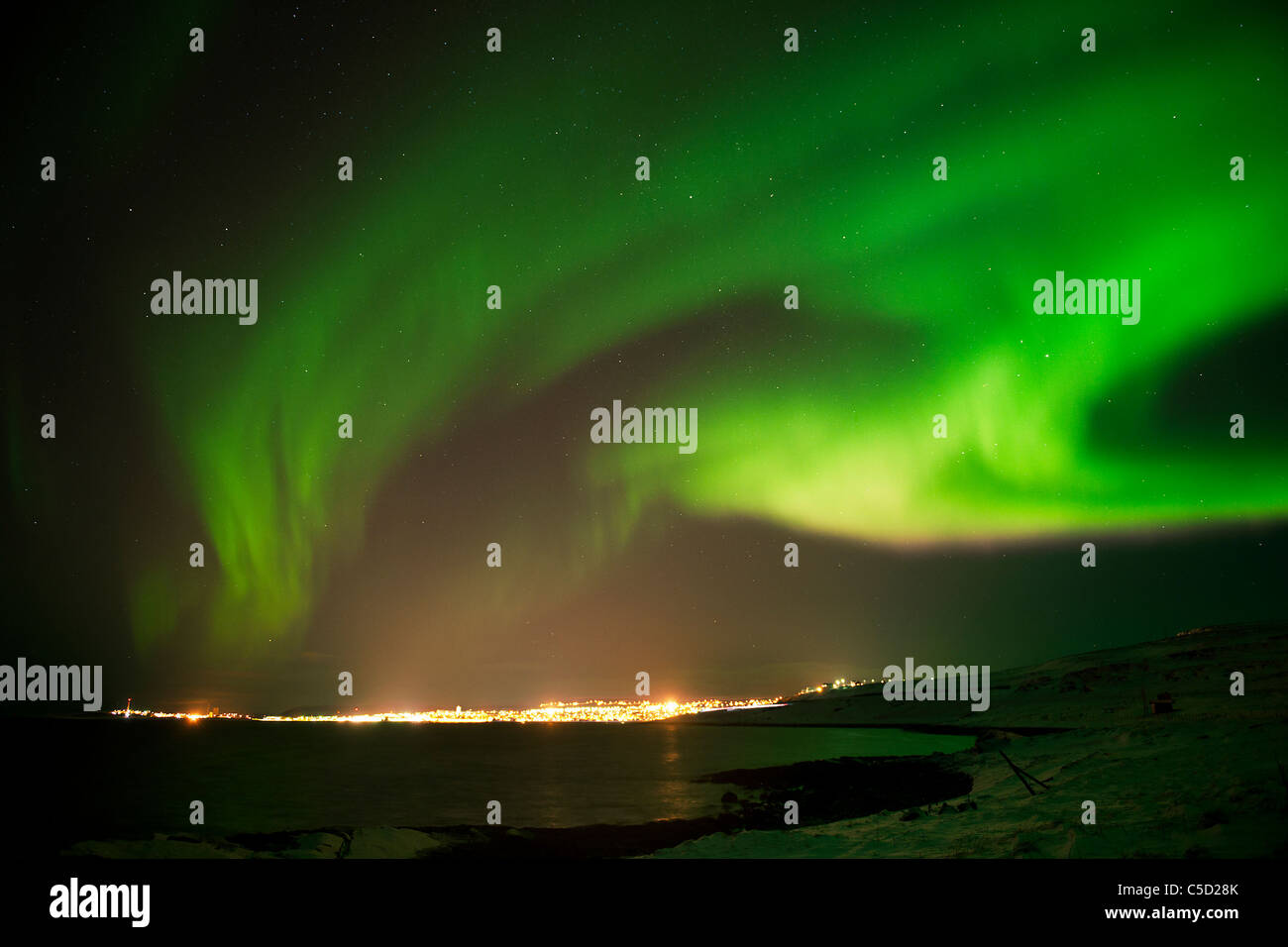 Aurora Borealis or Northern Lights over landscape in Norway - Stock Image