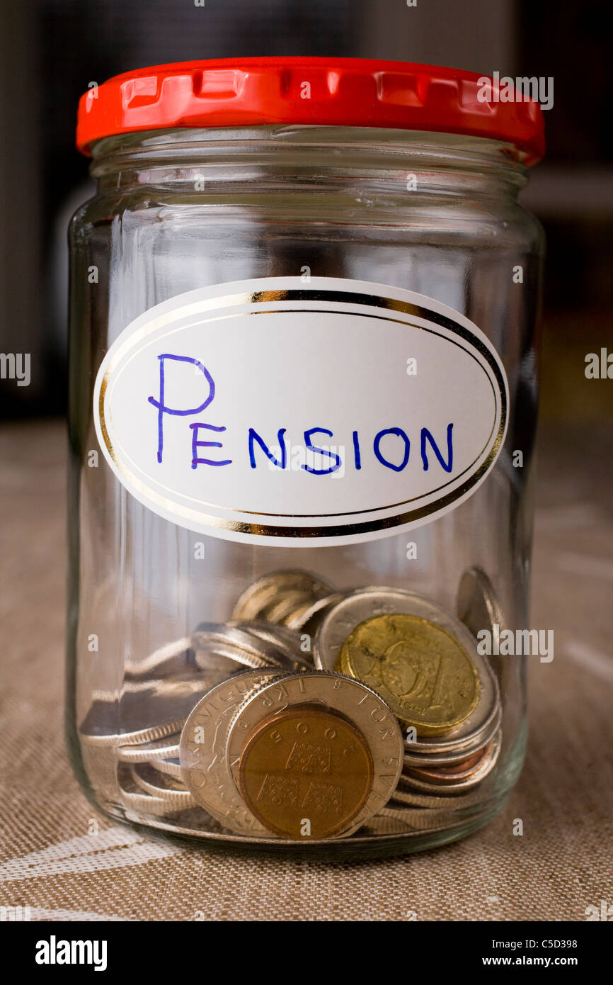 Close-up of pension funds in a glass jar - Stock Image
