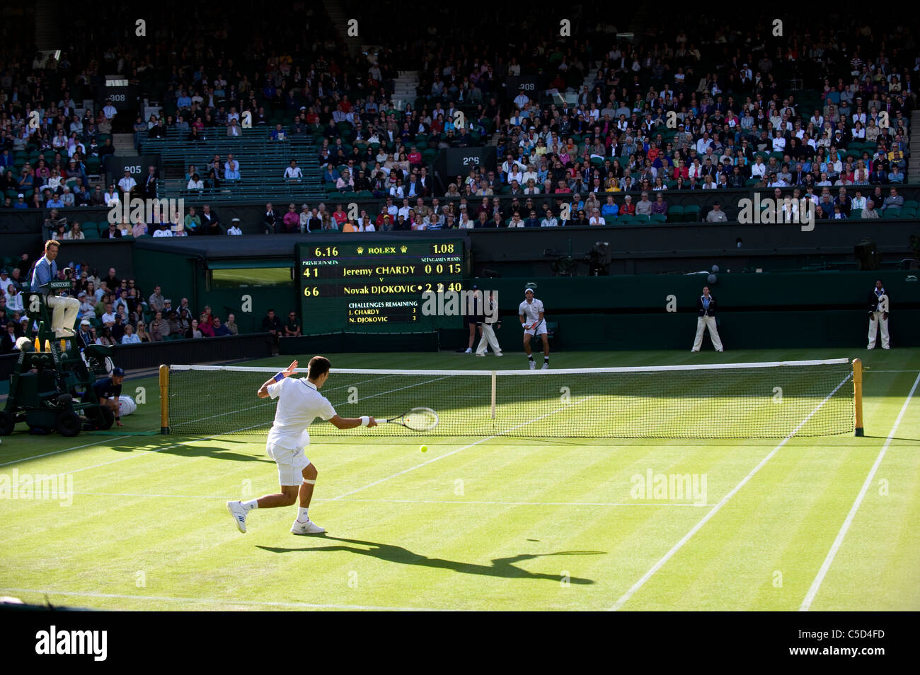 Action during Novak Djokovic (SRB) v Jeremy Chardy (FRA) match on Centre Court during the 2011 Wimbledon Tennis - Stock Image
