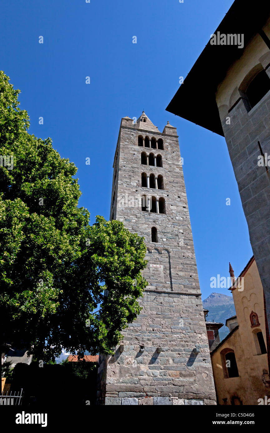 The imposing steeple of the St Peter and St Ursus Collegiate church (Aosta - Italy). L'imposant clocher de la - Stock Image