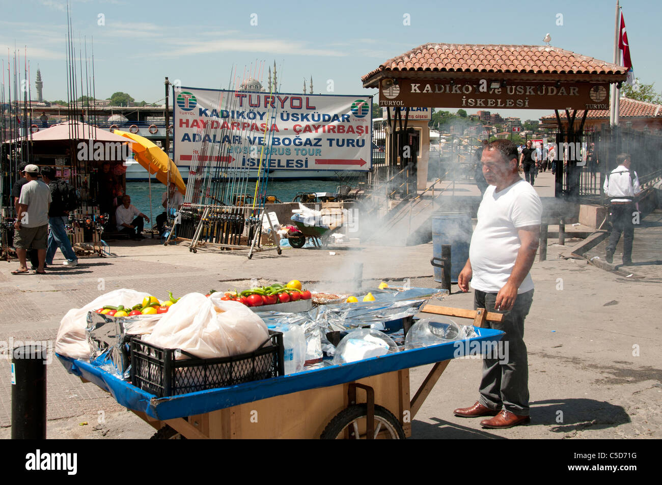 Restaurant terrace boats Golden Horn bridge waterfront selling hot mackerel fish sandwiches balik ekmek - Stock Image
