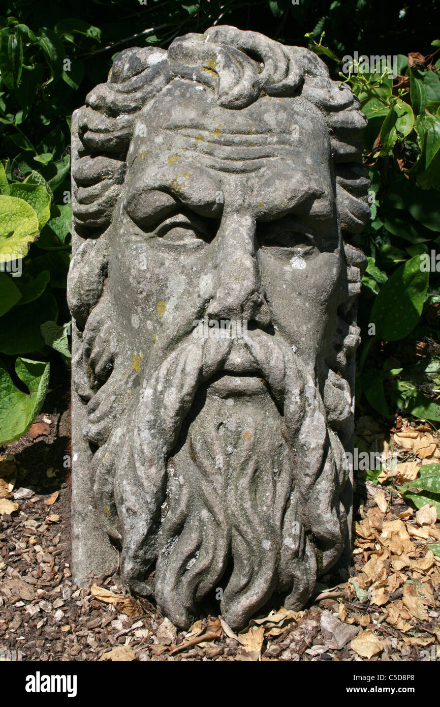 Stone Statue Of An Old Bearded Man at Ness Botanical Gardens, Wirral, UK - Stock Image