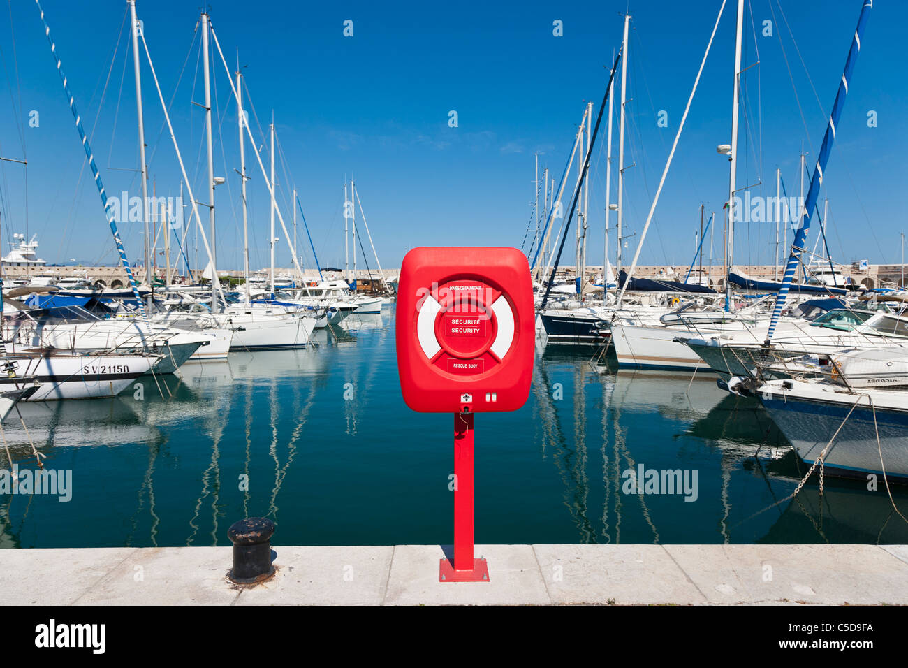 Life saving ring in front of Boats and yachts in Antibes Marina, Antibes, Cote d'Azure, France - Stock Image