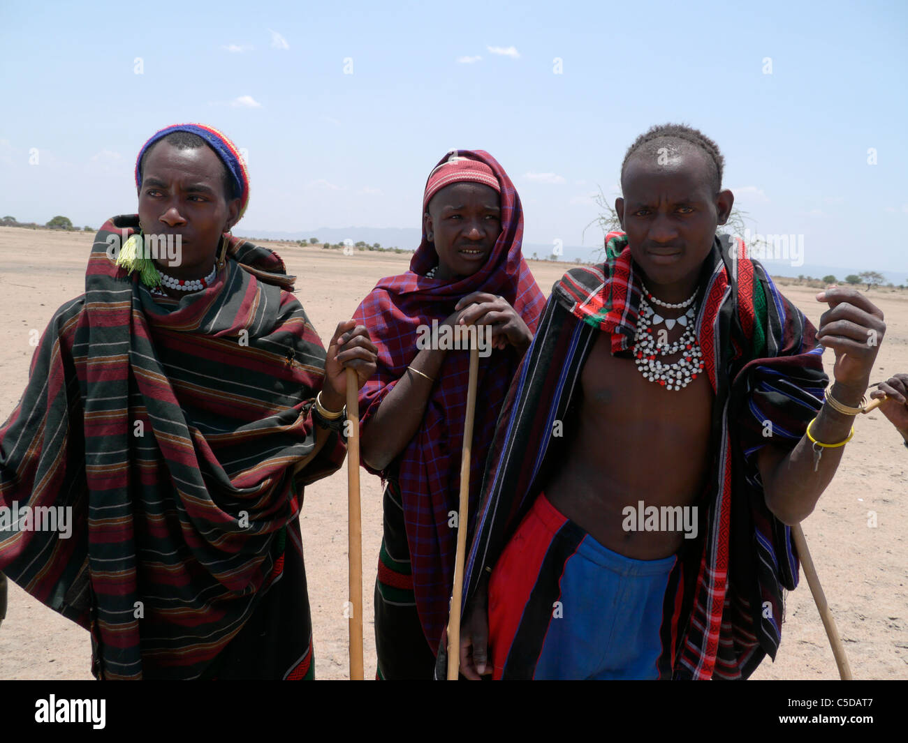 TANZANIA Watatulu tribesmen of Miyuguyu, Shinyanga district. Group of men wearing traditional clothes and beads. Stock Photo