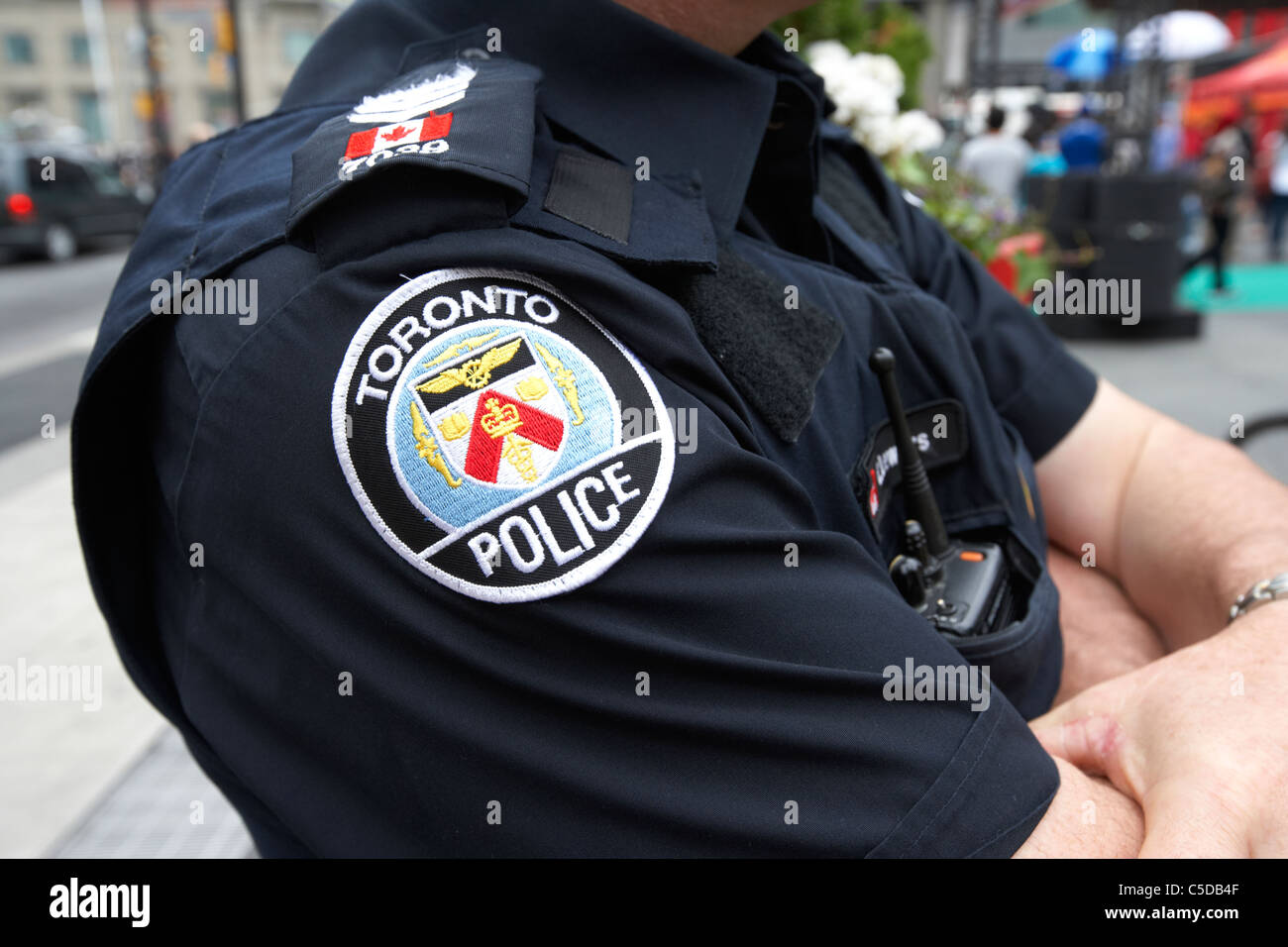 badge on uniform of toronto police officer toronto ontario canada - Stock Image