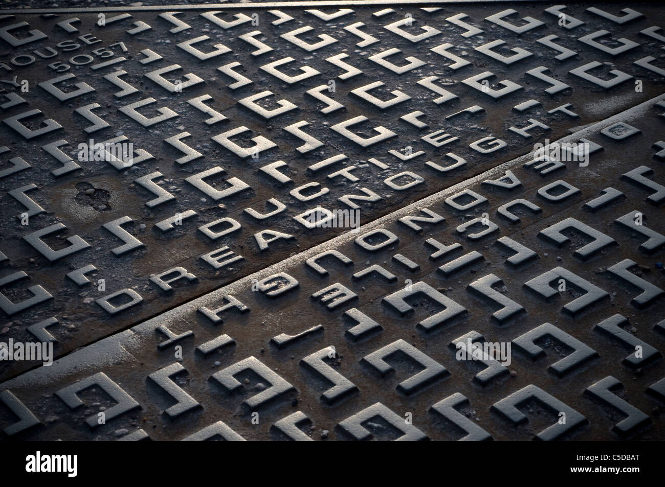 Dreadnought drain cover,drains, pattern, shadow, pavement, cover - Stock Image