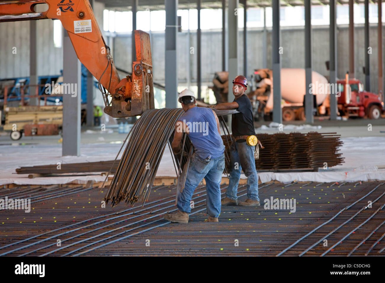laying rebar for concrete reinforcement stock image