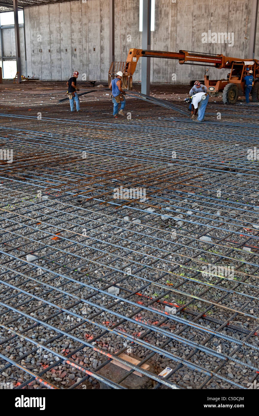 Laying Rebar for Concrete Reinforcement - Stock Image