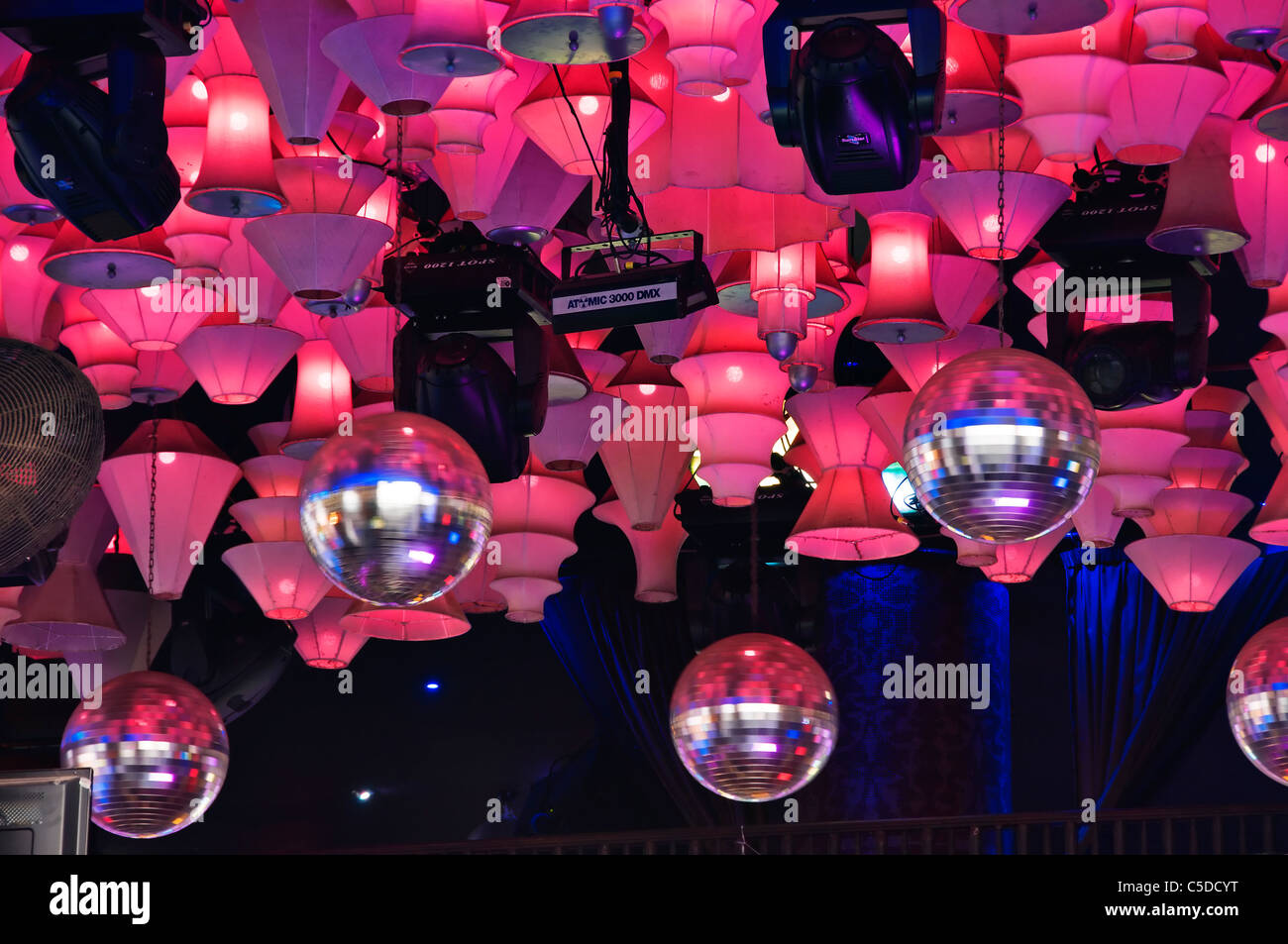 Disco ball lights stock photos disco ball lights stock images alamy spinning disco balls and lots of pink lights hang from the ceiling of a nightclub on aloadofball Images