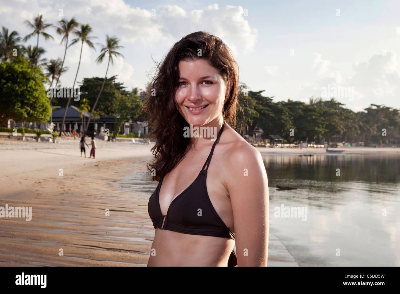 Model posing on a tropical beach Stock Photo