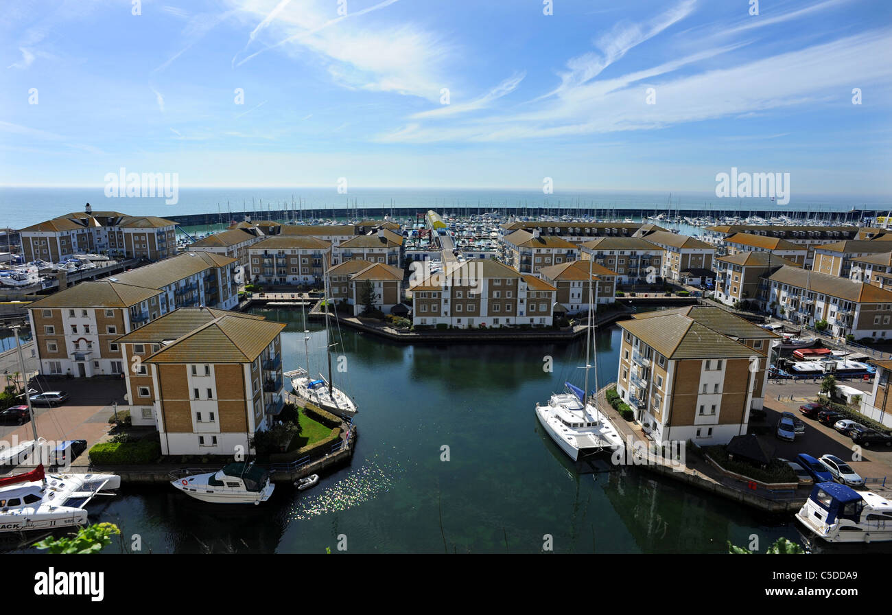 Houses and boats in Brighton Marina - Stock Image