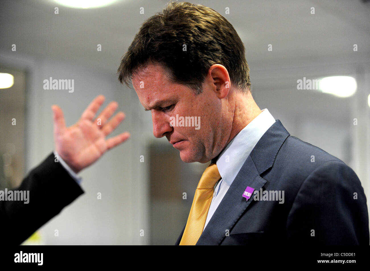 A hand looks like its about to slap Deputy Prime Minister Nick Clegg during a visit to the Newhaven Enterprise Centre - Stock Image