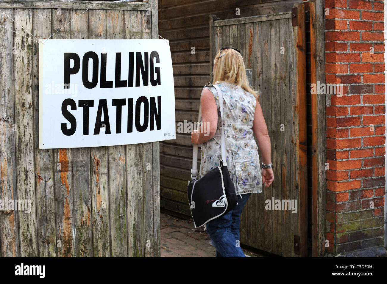 A woman walks into a Polling Station to vote in the 2011 Local Elections - Stock Image