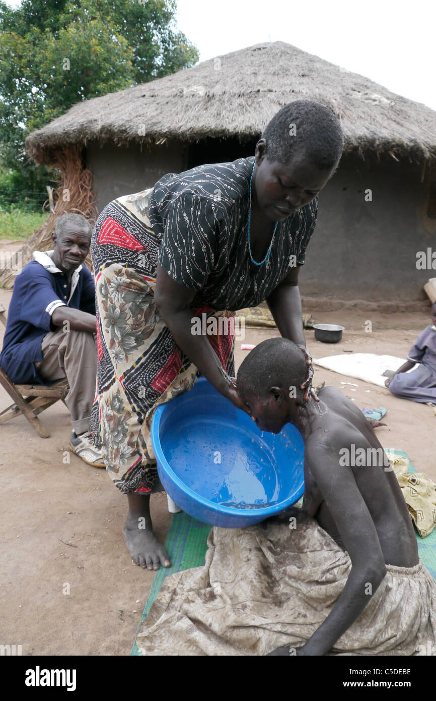 UGANDA The work of Comboni Samaritans, Gulu. Visiting Atoo Alice, 48, who has AIDS and suffers from depression... - Stock Image