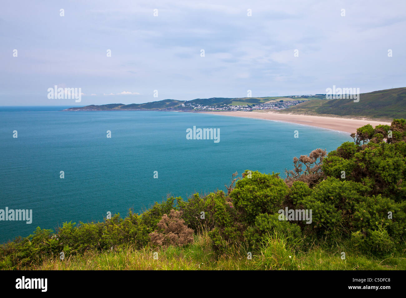 View towards Woolacombe and Woolacombe Sands taken from the coastal path near Croyde, North Devon, England, UK - Stock Image