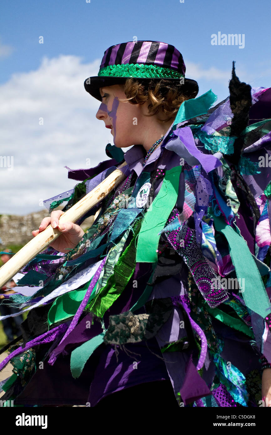 Exmoor Border Mixed Morris Dancers, black-faced, wearing long flowing torn old rags, clothing made from wide bolts Stock Photo