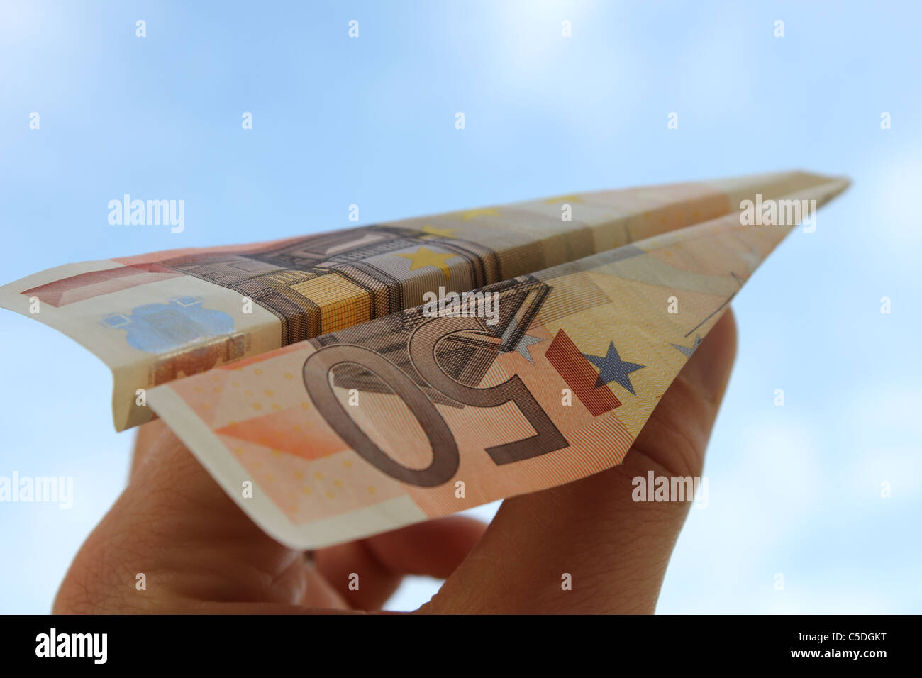 paper plane made from a 50 euro note - Stock Image