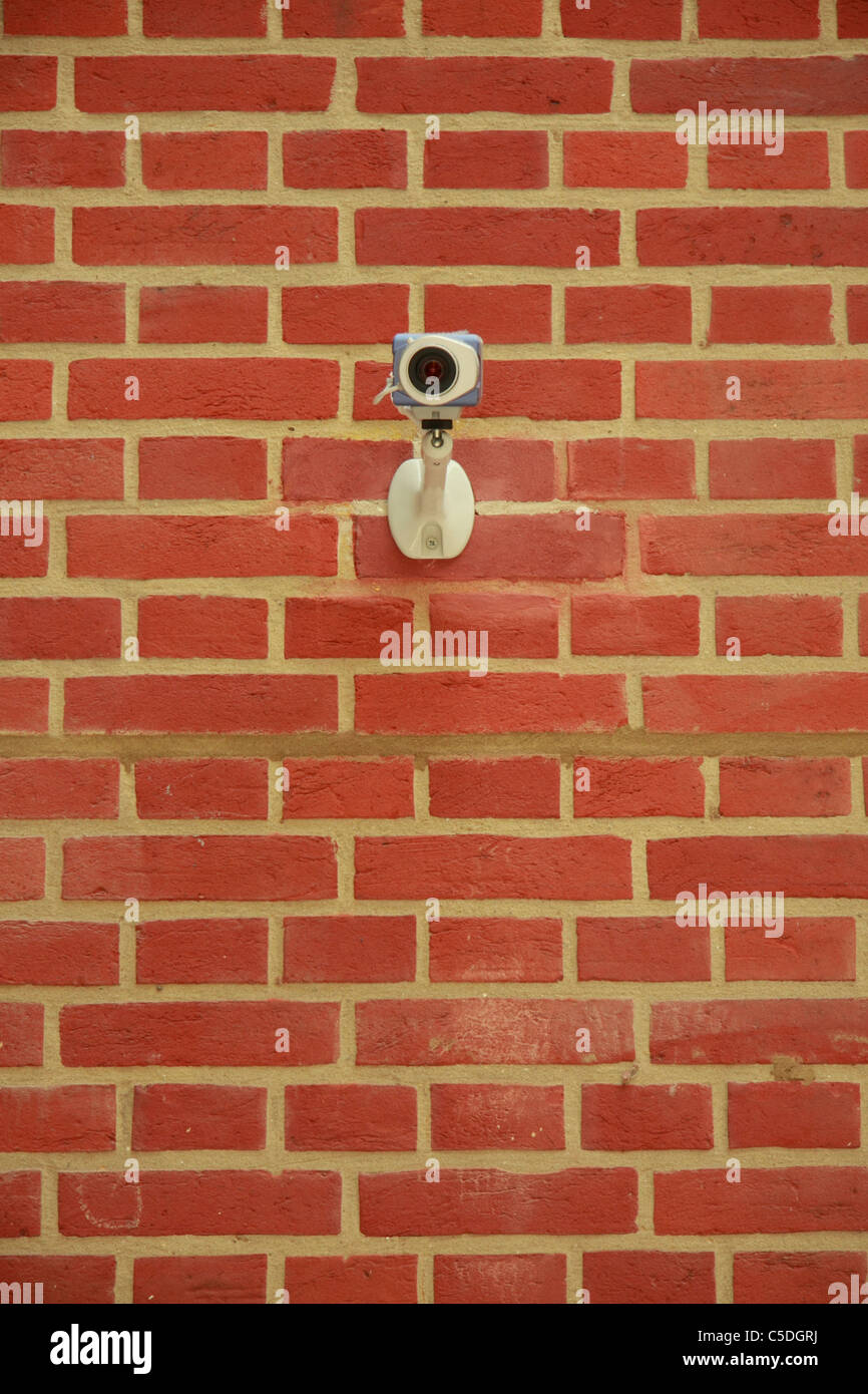 Brick wall with CCTV camera - Stock Image