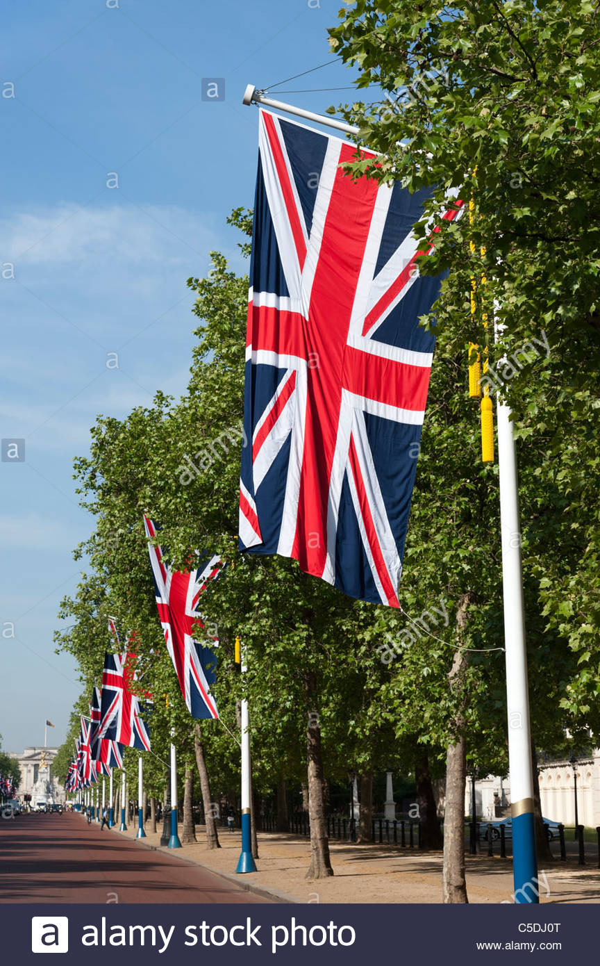 Union Jack flags lining the Mall towards Buckingham Palace for state occasion, London, UK - Stock Image