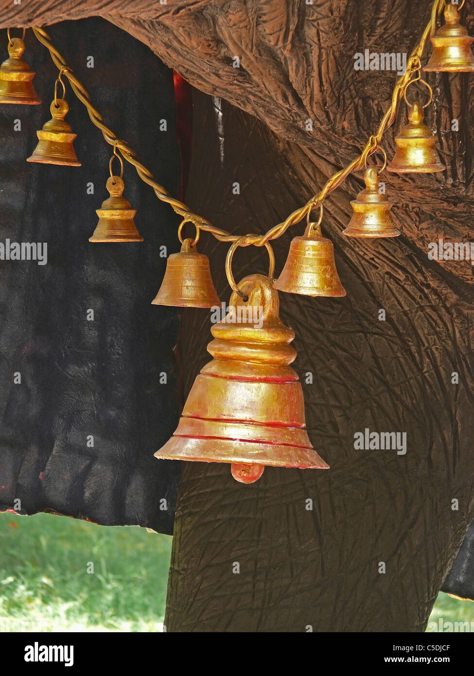 Garland of Brass bells in elephant neck\'s statue, Empress garden ...