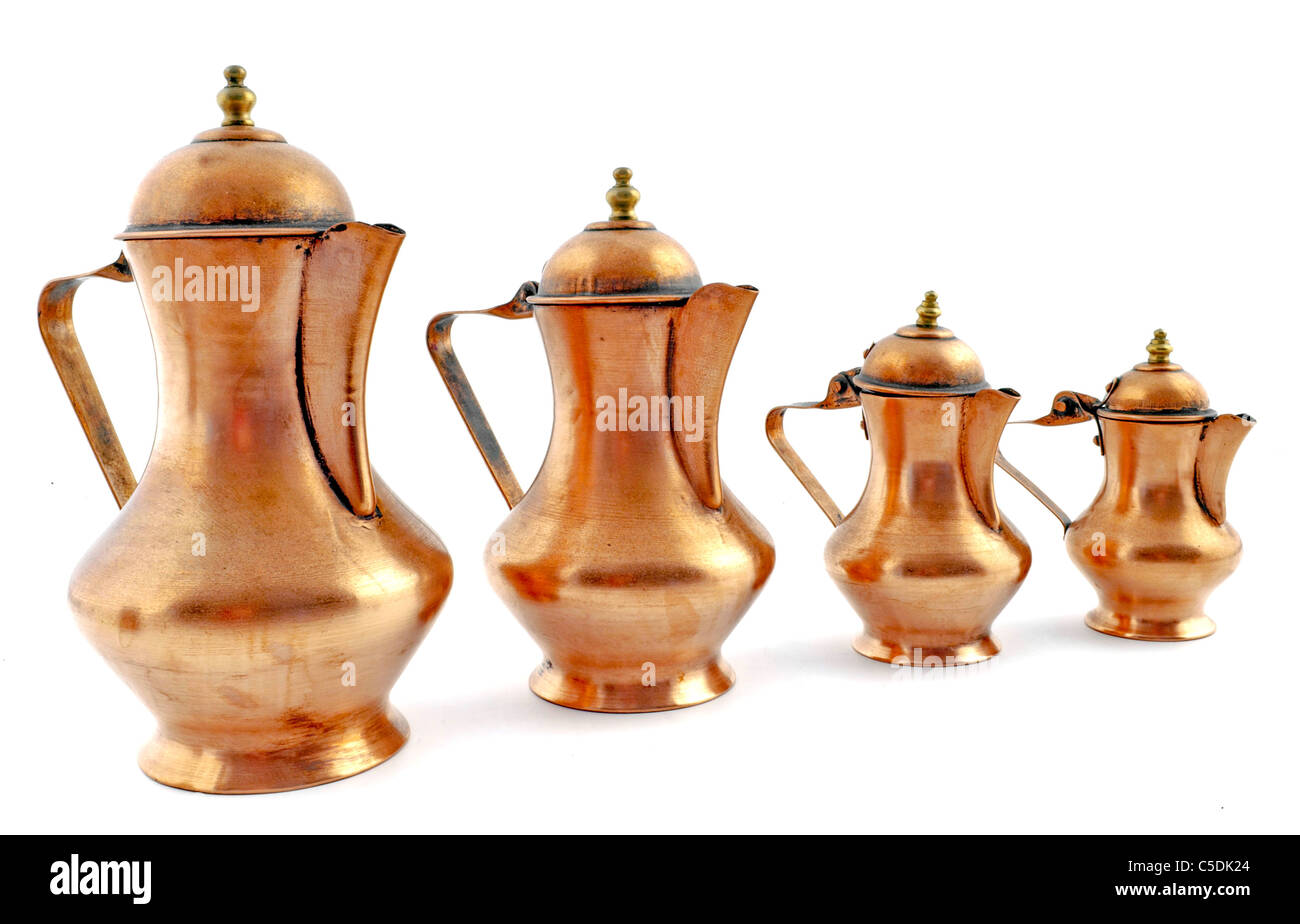 Isolated copper coffeepot on white background - Stock Image