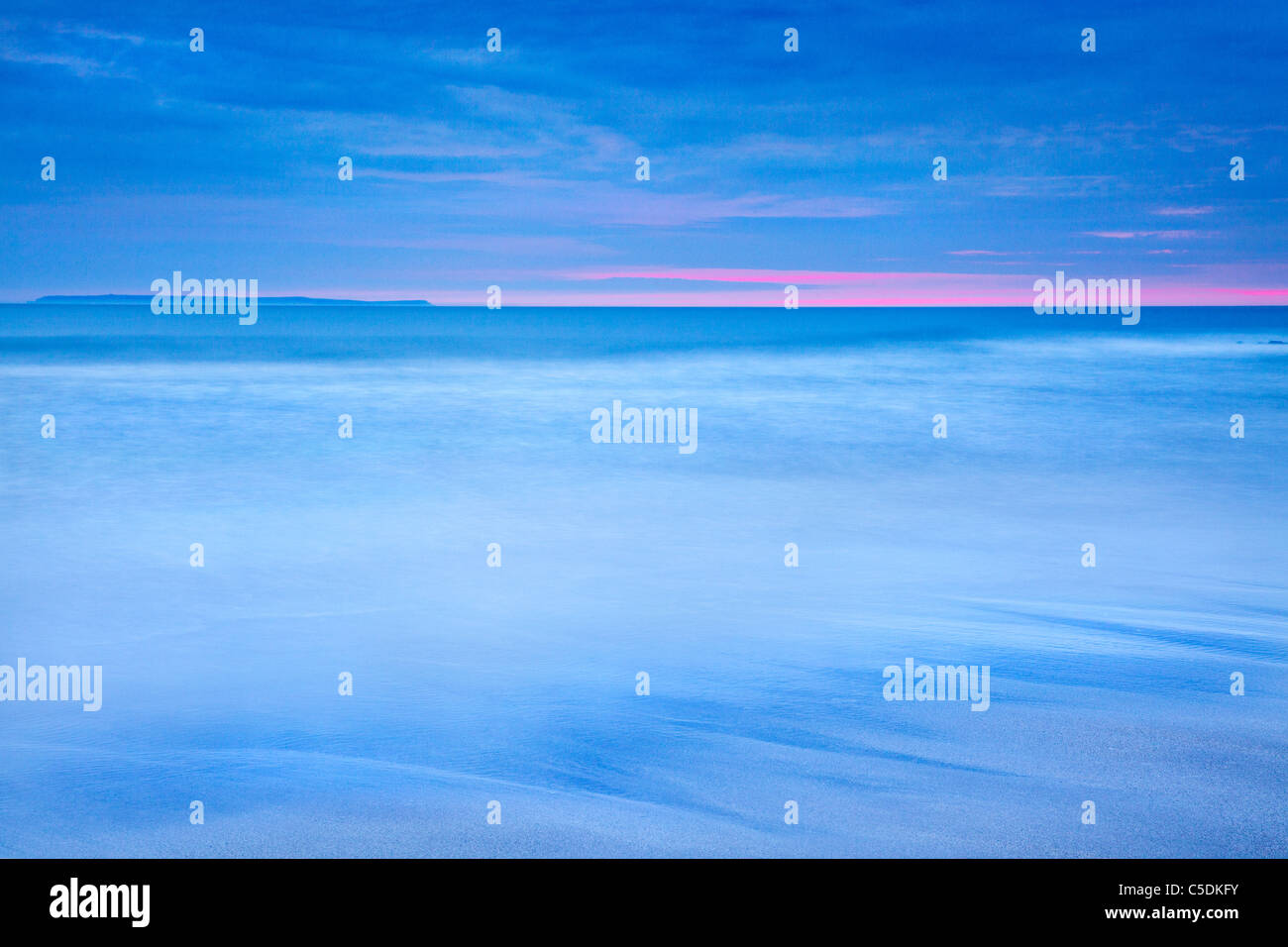 Twilight view of Lundy Island taken at dusk from Croyde Bay, North Devon, England, UK - Stock Image
