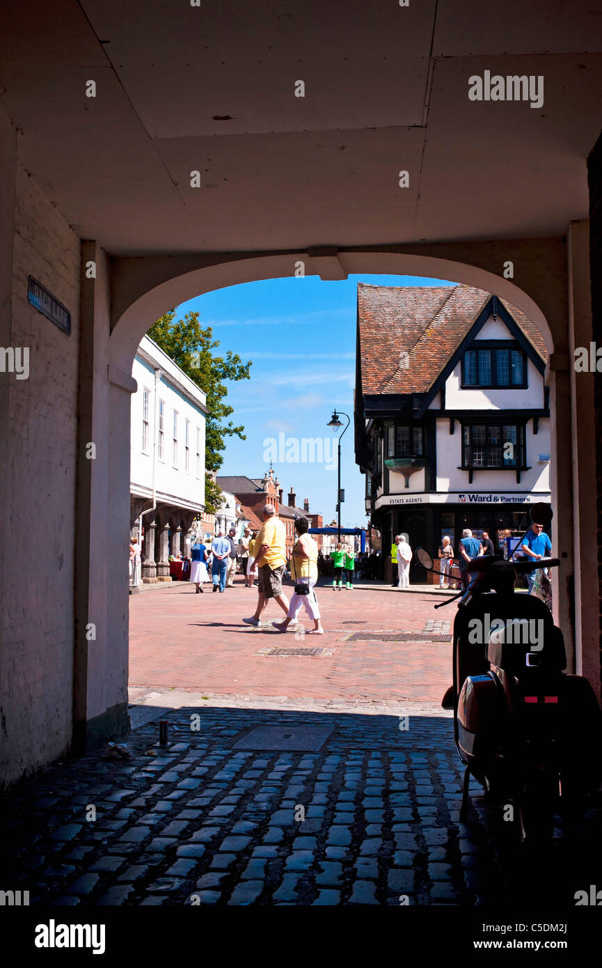 View of Market Place through covered alley of the picturesque town of Faversham in Kent Stock Photo