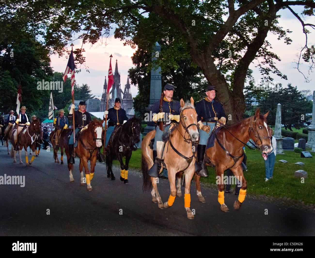 Riding horses, Civil War reenactors wearing period uniform meet on Memorial Day in Green-Wood Cemetery in Brooklyn, - Stock Image