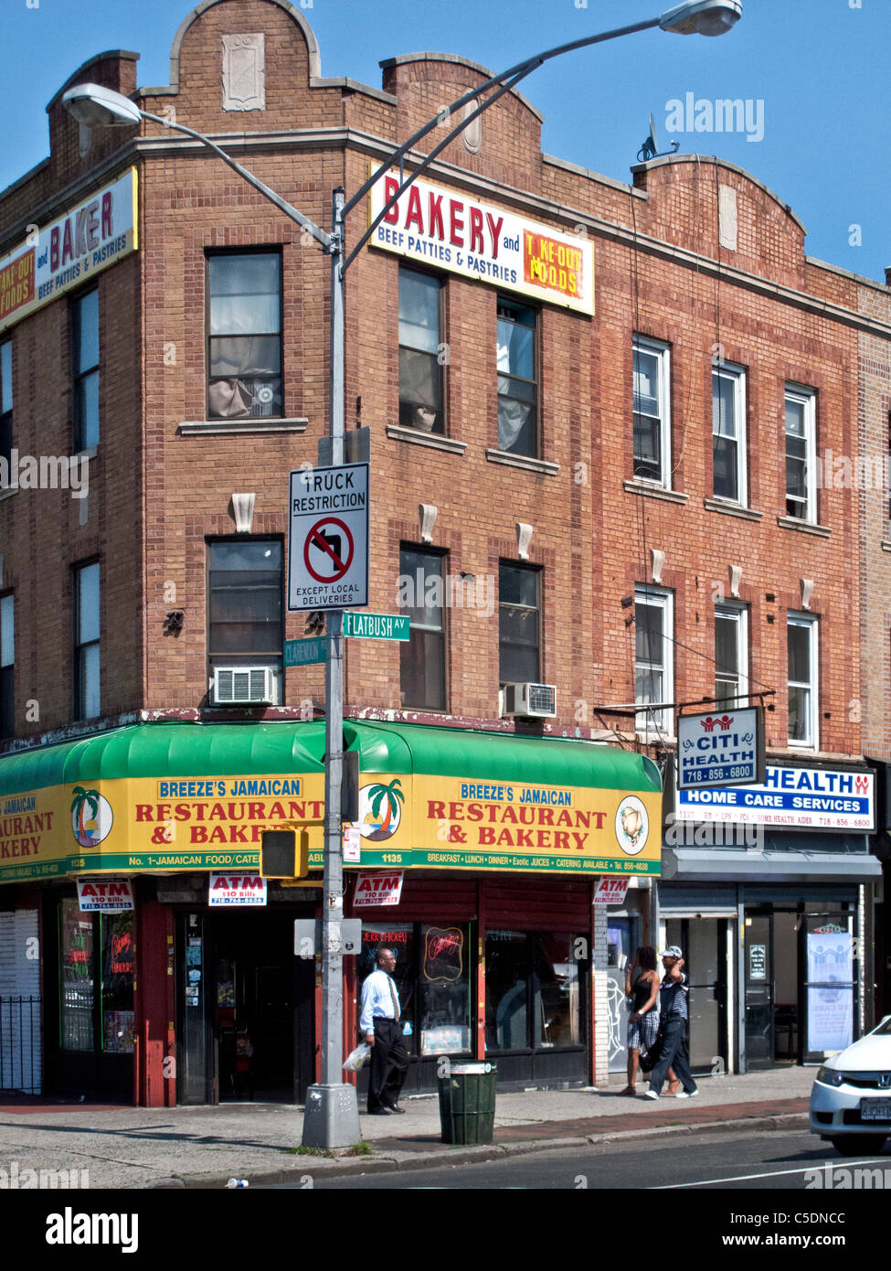 A Jamaican restaurant does business on Flatbush Avenue in the 'Little West Indies' neighborhood of Brooklyn, - Stock Image
