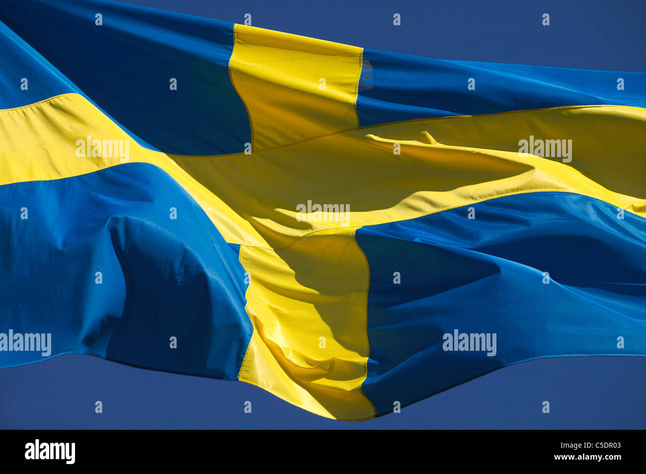 Detail shot of fluttering Swedish flag - Stock Image