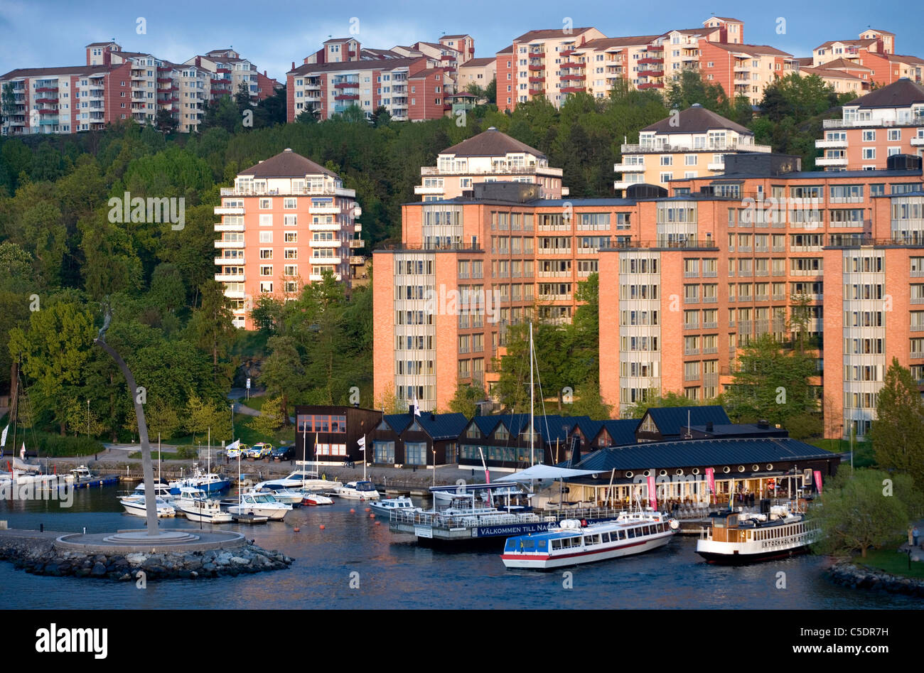Apartment buildings with moored boats in foreground at Nacka Strand, Stockholm, Sweden Stock Photo