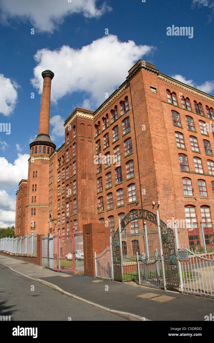 Victoria Mills (1867  + 1873) on Rochdale Canal, Miles Platting, Manchester, UK. Now residential, business and educational - Stock Image