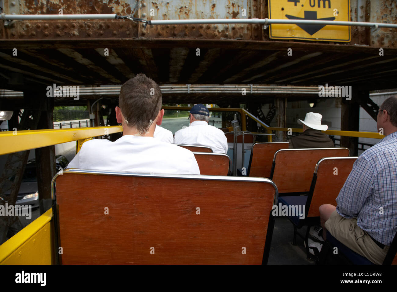 tourists on sightseeing bus going under low bridge toronto ontario canada - Stock Image