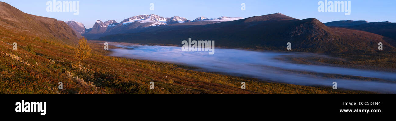 Panoramic shot of mountain landscape with Kebnekaise in the background at Sweden - Stock Image