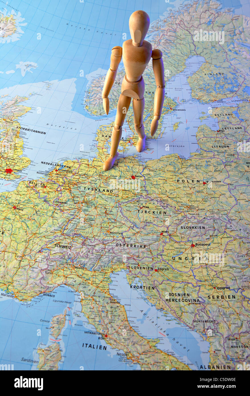 Close-up of a mannequin standing on the map - Stock Image