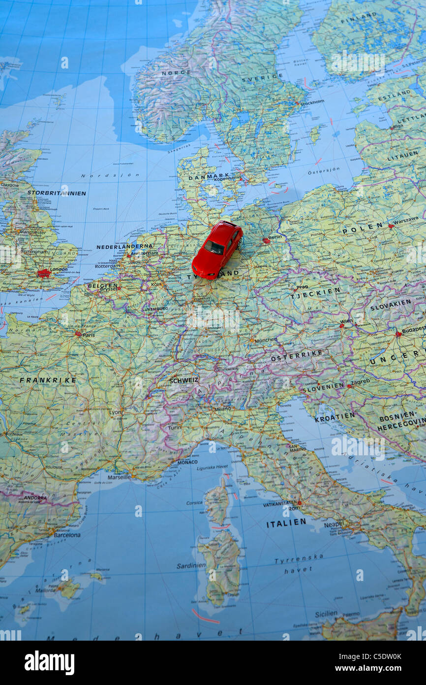 Close-up of a red car on the map - Stock Image