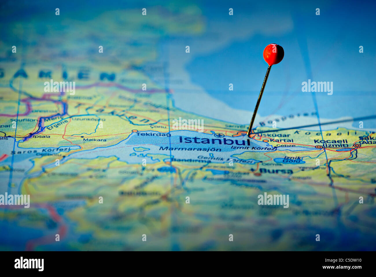 Close-up of a red map pin on Istanbul at a map - Stock Image