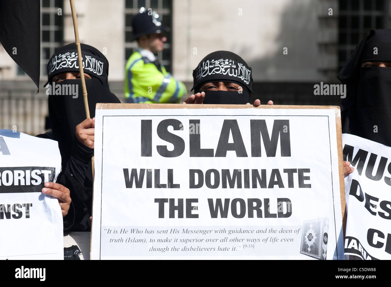 Muslim women wearing the niqab demonstrating for Muslim domination of the world in London, UK - Stock Image