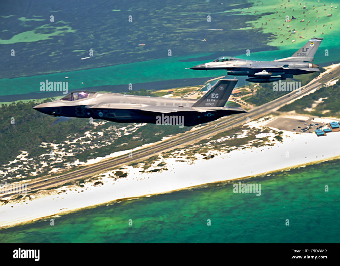 F-35 Joint Strike Fighter Lighting II flying above the coast of Florida - Stock Image