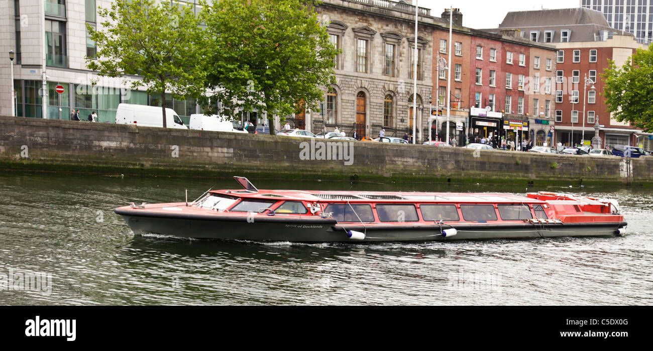 The Spirit of Docklands, a sightseeing boat run by Liffey River Cruises, on the River Liffey in central Dublin. - Stock Image