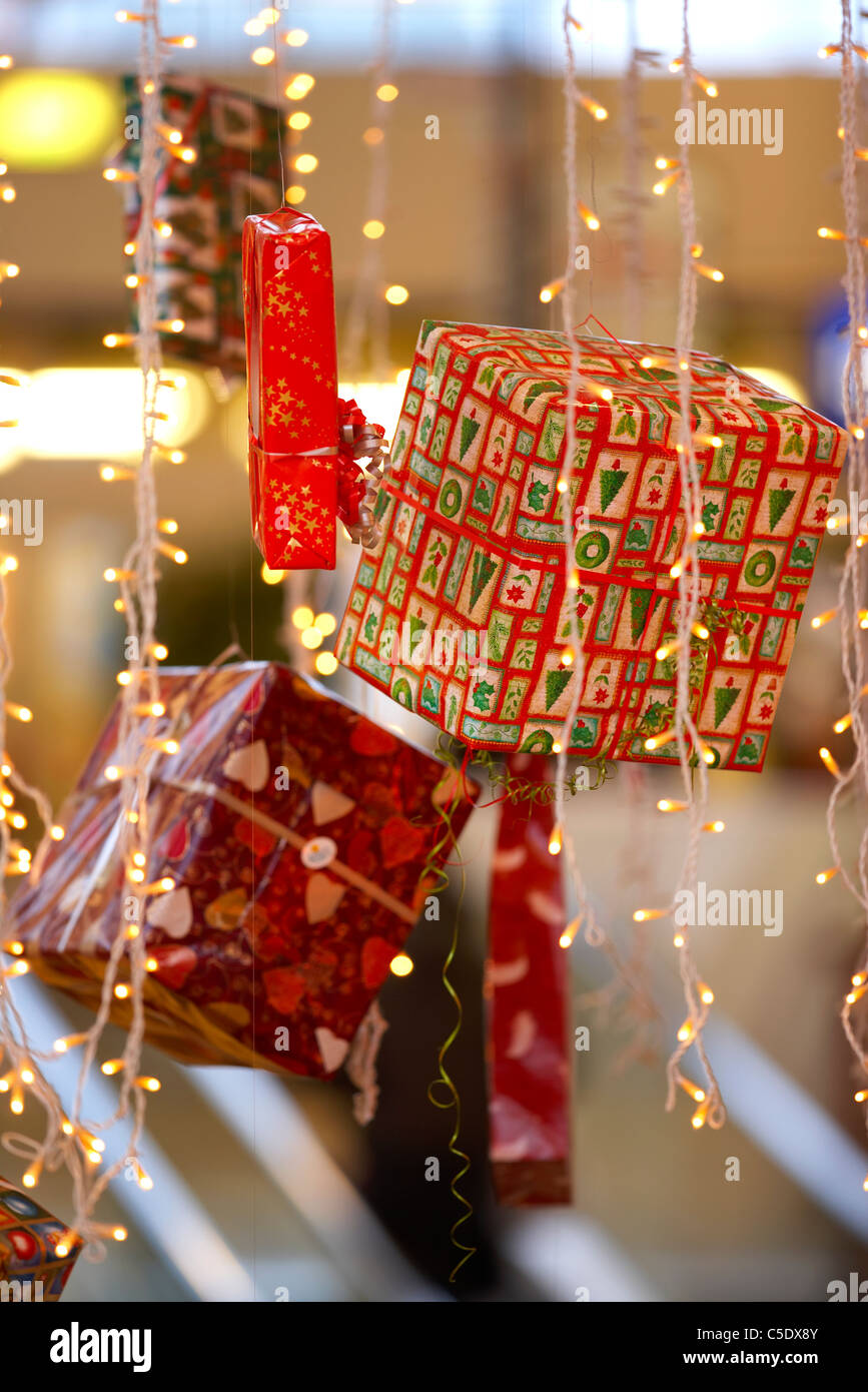 Close-up of Christmas presents and hanging lights Stock Photo