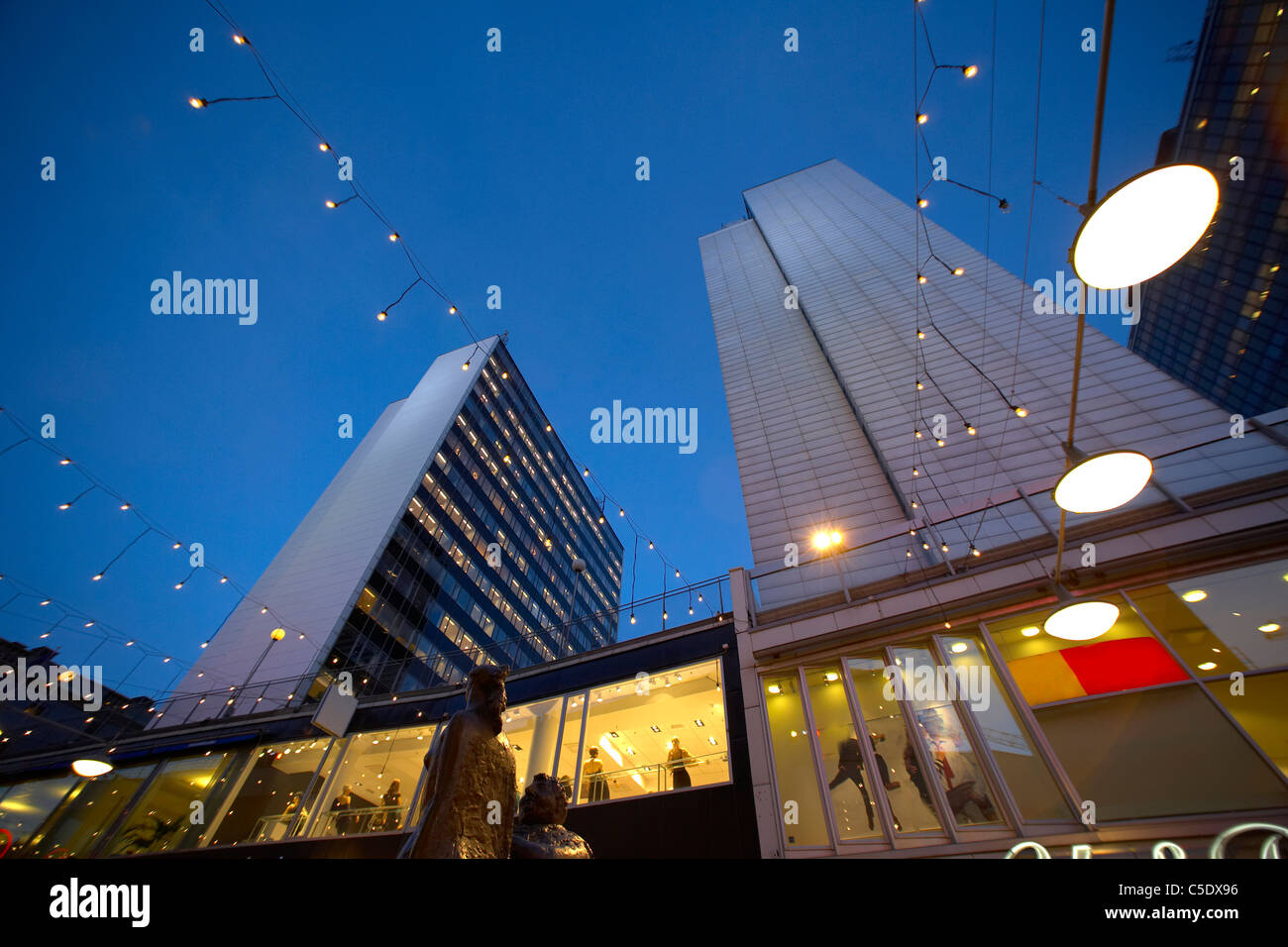 Low angle view of skyscrapers with hanging lights against blue sky in Stockholm, Sweden Stock Photo
