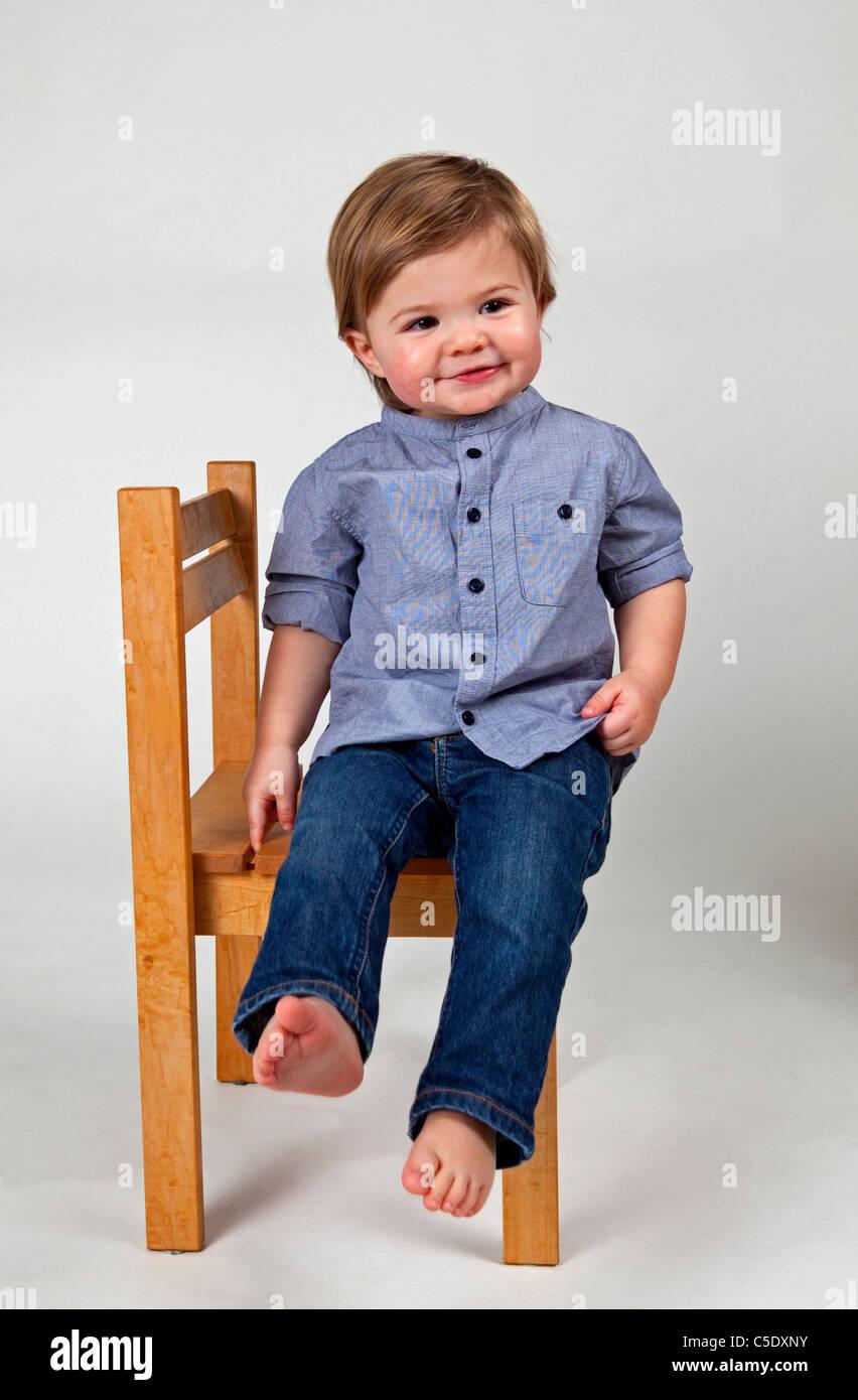 Little Boy Sitting Alone On Stock Photos & Little Boy