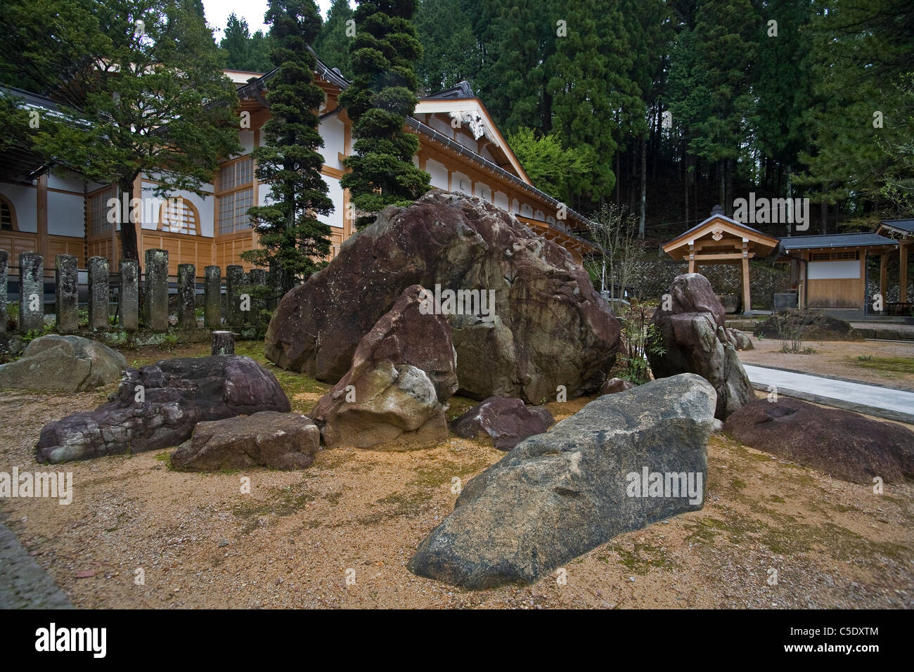 Boulder garden in front of a Japanese mountain retreat - Stock Image